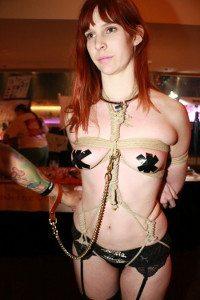 Girl in Bondage and Dog Leash at AVN/AEE
